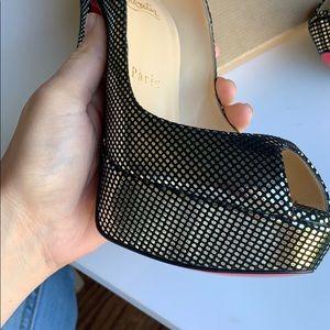 Christian Louboutin peep toe shoes.